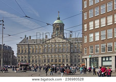 Amsterdam, Holland - 14 April 2018 Facade Of The Royal Palace In The Central Square Of Amsterdam. Am