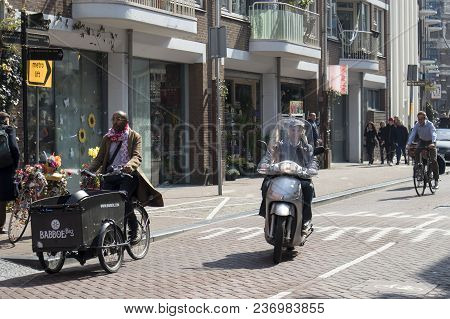 Amsterdam, Holland - 14 April 2018 View Of Bicyclist On Amsterdam Street, Netherland
