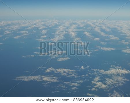 Blue Sky And Scenery Of Cloud Formation Panorama As Seen Through Window Of An Aircraft Above Europe