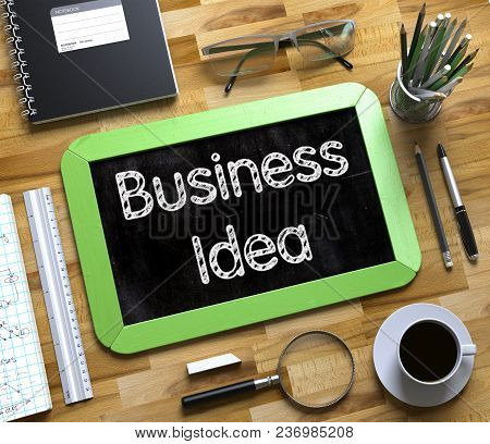 Business Idea - Text on Small Chalkboard.Green Small Chalkboard with Handwritten Business Concept - Business Idea - on Office Desk and Other Office Supplies Around. Top View. 3d Rendering. poster