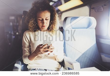Enjoying Travel Concept. Young Pretty Woman Tourist Traveling By The Train Sitting Near The Window U