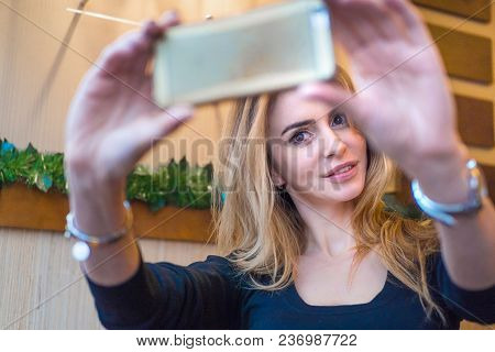 Portrait Of Middle Aged Caucasian Woman Making Selfie Photo With Her Phone
