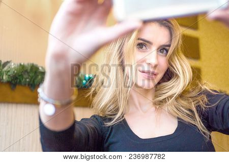 Attractive, Successful And Happy Middle Aged Woman Female Taking Selfie Photograph On Mobile Cell Ph