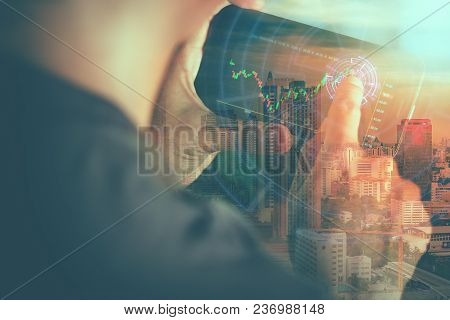 A Man Checking Stock Market On Tablet. Double Exposure, Close Up, Future Concept