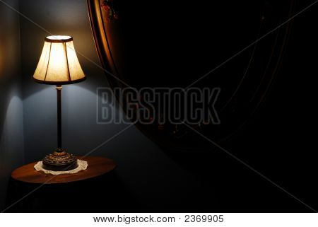 Stair Landing Night Lamp, Table, And Antique Wall Mirror