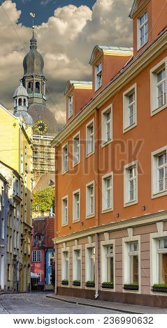 Narrow Medieval Street In Old Riga - Capital Of Latvia. In Old Riga City Tourists Can Find A Unique