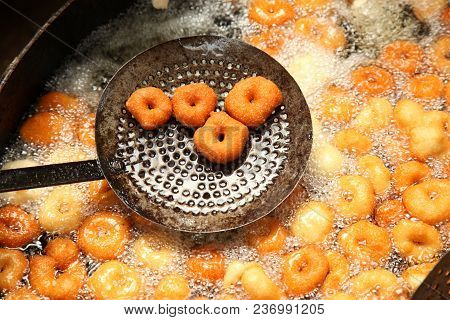 Deep Frying Medu Vada In The Pan. Medu Vada Is A Savoury Snack From South India, Very Common Street
