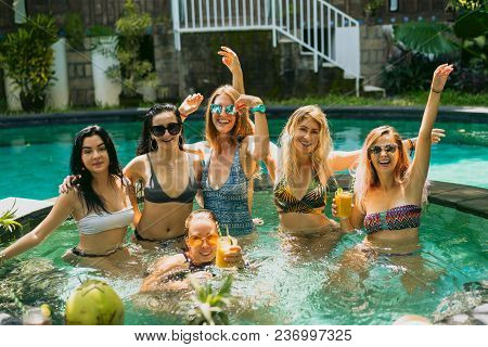 Beautiful Young Women In Swimwear And Sunglasses Smiling At Camera While Having Fun Together At Swim