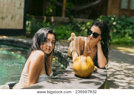 Beautiful Young Women Resting At Swimming Pool