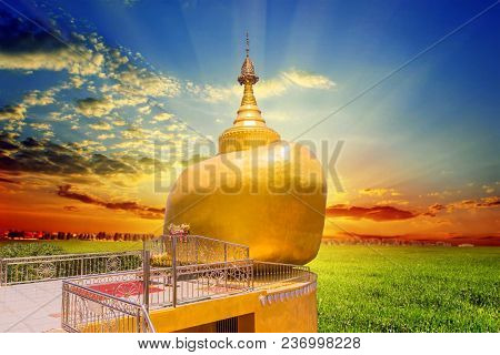 The Replica Of Phra That In-kwaen (hanging Golden Rock) With Sunset Background, At Koh (islands) Sir