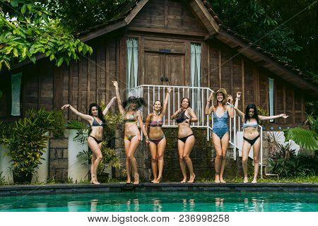 Beautiful Girls In Swimwear Posing Near Swimming Pool
