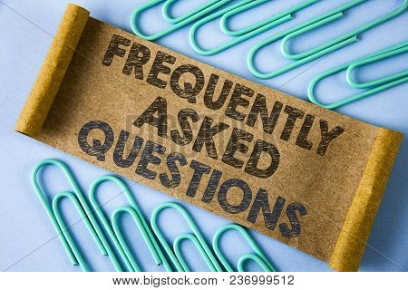 Text sign showing Frequently Asked Questions. Conceptual photo most common inquiries Informations Help Guide written Folded Cardboard paper piece plain blue background within Paper Pins. poster