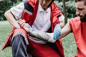 First aid paramedic in training, treating third degree burns poster