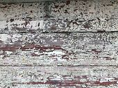 Texture of a black gray old dilapidated wooden wall, a fence with pieces of old shabby exfoliated paint from horizontal worn-out rotten boards with cracks and knots background poster