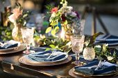 Vintage table setup for outdoor wedding reception. poster