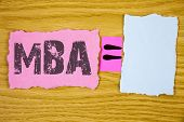 Writing note showing  Mba. Business photo showcasing Master of Business Administration Advance Degree After College Studies written Tear Sticky note paper wooden background Equation Space. poster