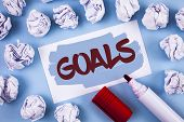Handwriting text Goals. Concept meaning Desired Achievements Targets What you want to accomplish in the future written Painted Sticky Note Paper within paper balls plain background Marker. poster