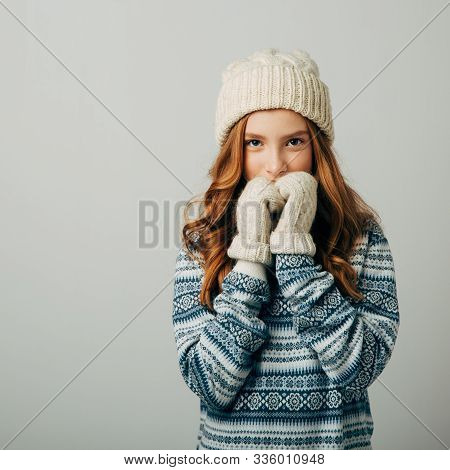 Teenager In A Knitted Hat, Sweater And Gloves. She Is Very Warm And Comfortable In This Dress. The G