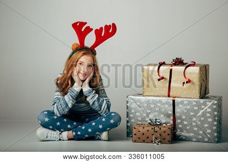 A Teenager With Red Deer Horns In A Sweater Bought Christmas Gifts For Parents At A Low Price. The G