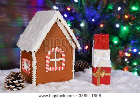 The Hand-made Eatable Gingerbread House, Snow Decoration, Gifts And New Year Tree With Garland In Ba