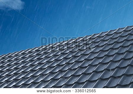 Rain Pours On The Metal Roof Tiles Of The House. Rain On The Roof. Modern Roof Made Of Metal. Corrug
