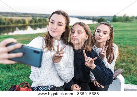 Three Teenage Girls, Teenagers In Summer City Have Rest After School College, Hands Smartphone, Self
