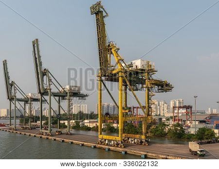 Ho Chi Minh City, Vietnam - March 13, 2019: Vict Port On Song Sai Gon River At Sunset. 3 Idle Cranes