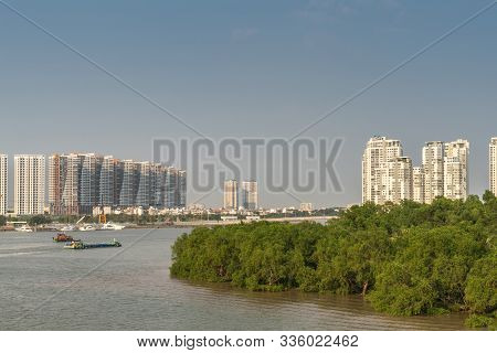 Ho Chi Minh City, Vietnam - March 13, 2019: Song Sai Gon River At Sunset With Tall White-brown Resid