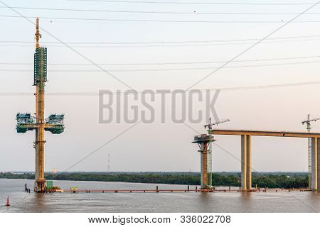 Phuoc Khanh, Vietnam - March 13, 2019: Long Tau River At Sunset. Western Pylon And On-ramp Of Phuoc