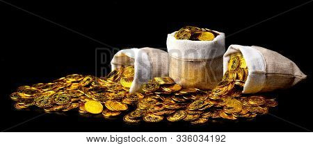 Stacking Gold Coin In Treasure Sack Lot Of At Black Background, Money Stack For Business Planning In