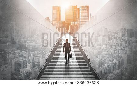 Ambitious Business Man Climbing Stairs To Meet Incoming Challenge And Business Opportunity. The High