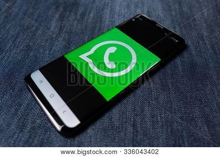 Odessa, Ukraine - October 26, 2019: Whatsapp App. Whatsapp Logo Visible On Smartphone Screen. Denim