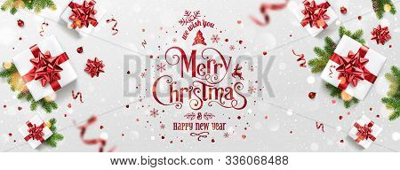 Red Christmas And New Year Text On Xmas Background With Gift Boxes, Fir Branches, Red Ribbon, Decora