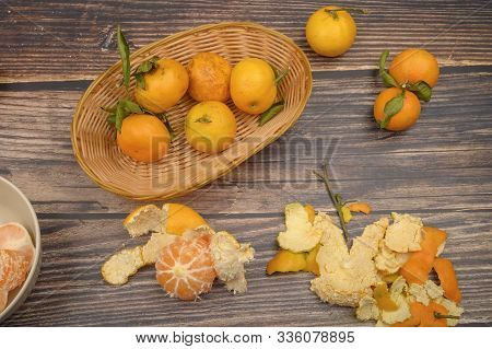 Peeled Tangerines In A Ceramic Dish, Tangerines On A Twig With Green Leaves, Tangerine Peel On A Woo