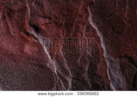 A Natural Background Made Of Multi-colored Wild Stone Close-up. View From Above