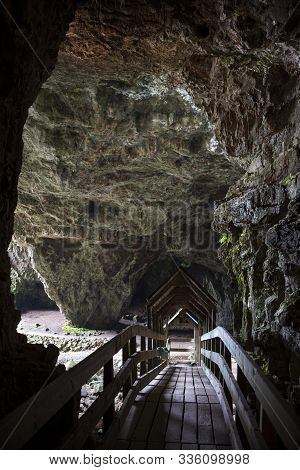 A Wooden Bridge At The Entrance Of Smoo Cave, A Large Combined Sea Cave And Freshwater Cave In Durne