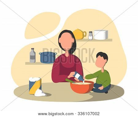 Cooking Together In The Kitchen. Mother With With A Small Child Preparing Meal, Son Helping Mom, Mot