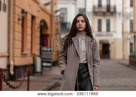 Pretty Young Woman Fashion Model In An Elegant Coat In Warm Golf In A Leather Stylish Black Skirt St