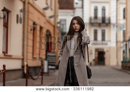 Pretty Elegant Beautiful Young Woman In Fashionable Outerwear With A Leather Stylish Black Handbag P