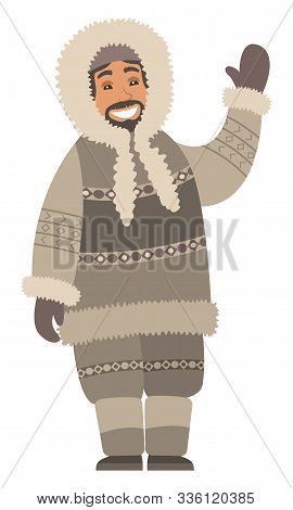 Eskimo Man Stand Alone And Wave Hand. Indigenous North Guy With Smile On Face And In Warm Clothes Li
