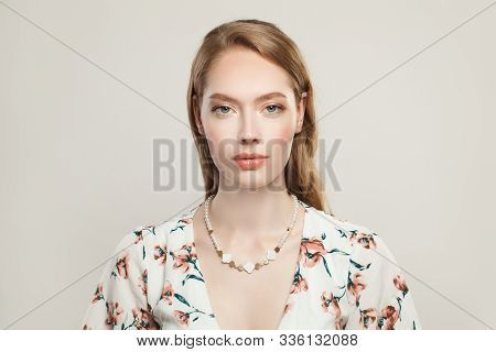 Jewelry Woman Fashion Model Wearing Luxurious Necklace With Pearls, Nacre And Golden Beads On White