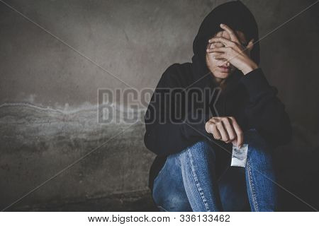 Depressed And Hopeless Teenage Girl Sitting Alone After Using Drugs, Drugs Addiction And Withdrawal