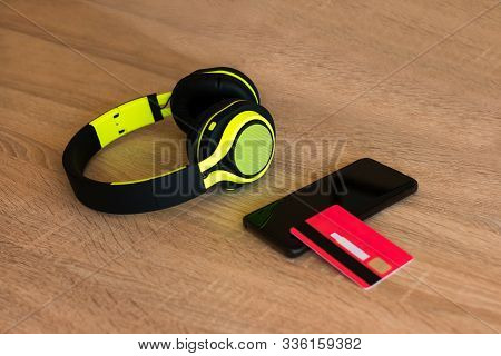 Stock Photo Of A Headphones, A Smartphone And A Credit Card On A Table