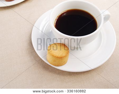 An Italian Amaretti Biscuits With A Cup Of Coffee Cup Of Coffee With An Individual Amaretti Biscuits