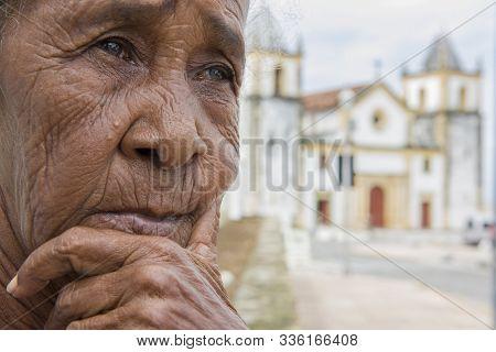 Olinda, Pernambuco, Brazil - June 06, 2016: Thoughtful Local Senior Woman In Alto Da Sé, A Scenic Sp