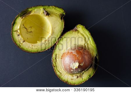 Close Up Image Of A Bruised And Imperfect Avocado On A Black Background- Use These And Avoid Food Wa