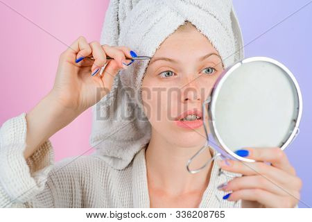 Eyebrows Beauty Care Concept. Beauty Tools. Woman Pulls Out Eyebrows With Tweezers. Correction Proce