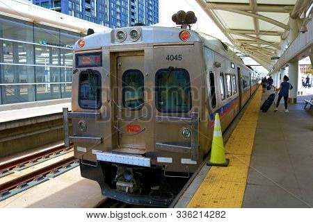 September 16, 2019 In Denver, Co:  Light Rail Train Arriving Then Quickly Departing To The Airport T