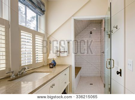 Bathroom interior with beautiful tile wheelchair accessible shower.