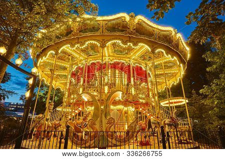 Merry Go Round Carousel Childhood Entertainment. Vintage Playground Attraction. Adorable
